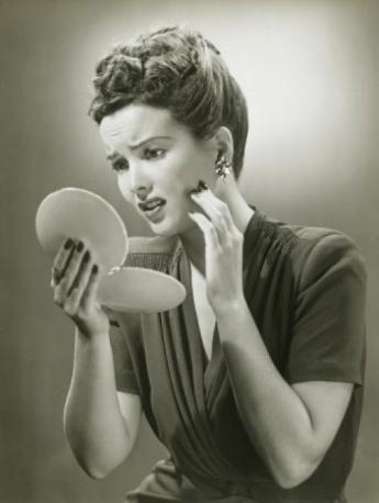 woman-looking-in-mirror-vintage-e1343019650424