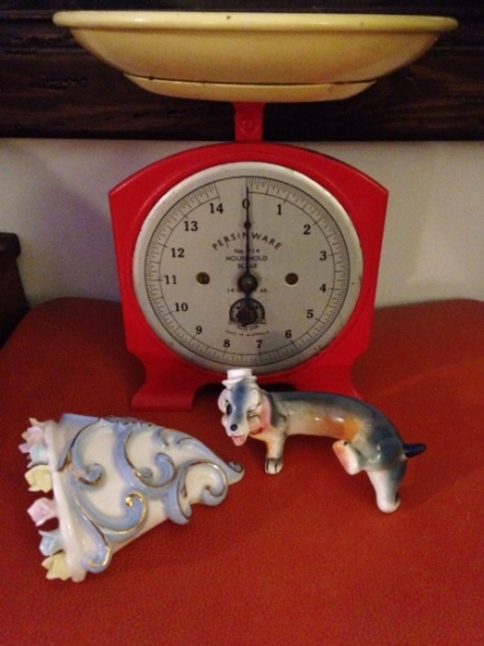 Vintage scales, kitsch dachshund, and vintage wall planter.