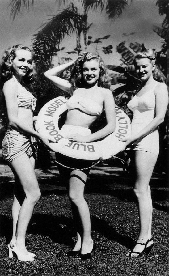 The American actress and model Marilyn Monroe wearing a bathing suit and lifebuoy for advertising. USA, 1940s (Photo by Mondadori Portfolio via Getty Images)